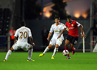 Pictured: Ki Sung-Yueng of Swansea (C) closely following Jacob Mellis of Barnsley (R). Tuesday 28 August 2012<br /> Re: Capital One Cup game, Swansea City FC v Barnsley at the Liberty Stadium, south Wales.