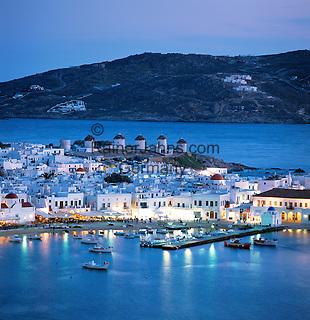 Greece, Cyclades, Mykonos: View over Harbour and Windmills at Dusk | Griechenland, Kykladen, Mykonos: Blick ueber Mykonos-Stadt und den Hafen zur Abenddaemmerung