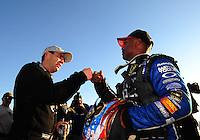 Oct. 16, 2011; Chandler, AZ, USA; NHRA top fuel dragster driver Larry Dixon (left) is congratulated by Antron Brown after winning the Arizona Nationals at Firebird International Raceway. Mandatory Credit: Mark J. Rebilas-