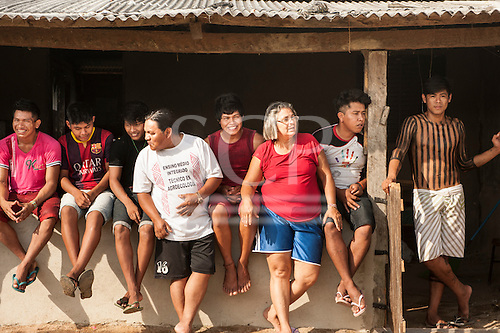Pará State, Brazil. Kayapó students of the Komomoyea Kovoero Indigenous Secondary School with their teachers Cirenio and Cicera Terena in the Aldeia Indigena Kuxonety Pokee, a Terena village in the Gleba Iriri Indigenous Territory.