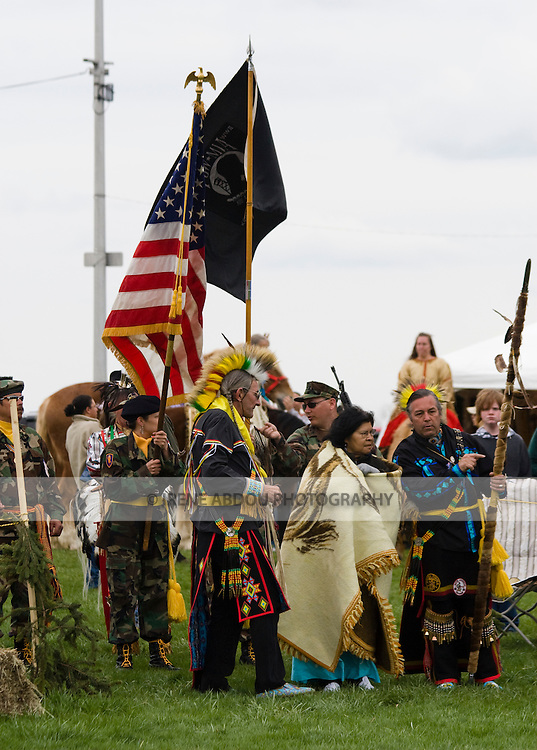 """Native Americans at the Healing Horse Spirit PowWow in Mt. Airy, Maryland carry an American flag POW-MIA flag.  They standy ready for the """"Grand Entrance.""""  Many Native Americans are U.S. soldiers or veterans."""