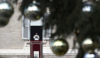 Papa Francesco recita l'Angelus domenicale affacciato su piazza San Pietro dalla finestra del suo studio. Citta' del Vaticano, 30 dicembre, 2018.<br /> Pope Francis is seen through the branches of a Christmas tree during the Sunday Angelus noon prayer from the window of his studio overlooking St. Peter's Square, at the Vatican, on December 30, 2018.<br /> UPDATE IMAGES PRESS/IsabellaBonotto<br /> <br /> STRICTLY ONLY FOR EDITORIAL USE