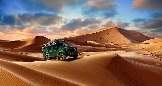4 x4 Landrover Defnder on the Sahara sand dunes of erg Chebbi at sunset , Morocco, Africa
