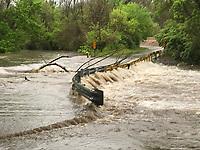 A flooded road on south Ball Street in Johnson. (NWA Democrat-Gazette/DAVID GOTTSCHALK)