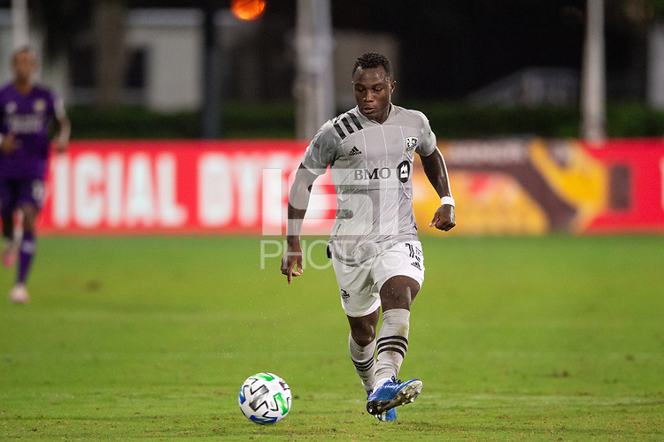 LAKE BUENA VISTA, FL - JULY 25: Zachary Brault-Guillard #15 of the Montreal Impact kicks the ball during a game between Montreal Impact and Orlando City SC at ESPN Wide World of Sports on July 25, 2020 in Lake Buena Vista, Florida.