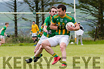 Lios Póil Tomas Ó Chiobhain in possession of the ball tackled by Castlegregory Padraig Ó Ruachain during the Junior Club Championship Round 2 match at Lispole GAA grounds on Sunday afternoon.