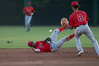 AZL Angels second baseman Jose Verrier (4) flips the ball to shortstop Jeremiah Jackson (8) to start a double play during an Arizona League game against the AZL Giants Black at the San Francisco Giants Training Complex on July 1, 2018 in Scottsdale, Arizona. The AZL Giants Black defeated the AZL Angels by a score of 4-2. (Zachary Lucy/Four Seam Images)