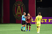 ATLANTA, GA - AUGUST 22: Eric Remedi #5 and referee Ted Unkel discuss a call during a game between Nashville SC and Atlanta United FC at Mercedes-Benz Stadium on August 22, 2020 in Atlanta, Georgia.