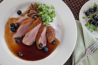 Pan Seared Duck Breast and Duck Confit: truffle potato purée, blueberry-Madeira sauce, micro greens<br /> Waterfront Bistro .Cruz Bay, St. John.U.S. Virgin Islands