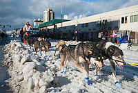 A dog team makes its way down Fourth Avenue at the ceremonial start of the 43rd Iditarod dog sled race in downtown Anchorage. 79 mushers made their way 11 miles through the slushy streets of Anchorage in unseasonably warm weather and early rain. This year's official re-start will begin in Fairbanks because of poor trail conditions in Southcentral Alaska.