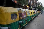 Auto rickshaws lined up on Rabindra Sarani in Kolkata due to 21 days lockdown in india for covid 19 pandemic. Kolkata, West Bengal, India. Arindam Mukherjee.