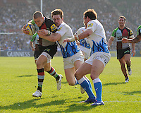 Mike Brown of Harlequins (left) is held up just short of the tryline by Tom Heathcote of Bath Rugby (centre) as Matt Carraro of Bath Rugby supports during the Aviva Premiership match between Harlequins and Bath Rugby at The Twickenham Stoop on Saturday 24th March 2012 (Photo by Rob Munro)