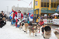 Mikhail Telpin and team leave the ceremonial start line at 4th Avenue and D street in downtown Anchorage during the 2013 Iditarod race. Photo by Jim R. Kohl/IditarodPhotos.com