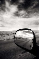 Empty road reflected in rear view mirror<br />