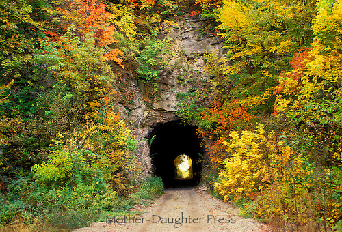 Tunnel on Rails to trails walking and biking path from MKT line. Fall foliage