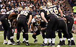 December 2009: New Orleans Saints quarterback Drew Brees (9) calls a play during an NFL football game at the Louisiana Superdome in New Orleans.  The Buccaneers defeated the Saints 20-17.