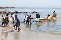 Dakar, Senegal.  Fishing Boat Landing  on the Beach at Soumbedioune Fishing Village, now a part of the metropolis of Dakar.
