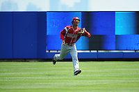 Batavia Muckdogs outfielder Yefri Perez (12) during game against the Staten Island Yankees at Richmond County Bank Ballpark at St.George on July 18, 2013 in Staten Island, NY.  Batavia defeated Staten Island 8-2.  (Tomasso DeRosa/Four Seam Images)