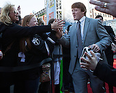 Ross Mauermann (PC - 14) passes his family. - The teams walked the red carpet through the Fan Fest outside TD Garden prior to the Frozen Four final on Saturday, April 11, 2015, in Boston, Massachusetts.