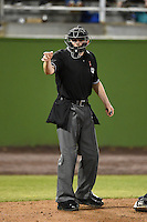 Home plate umpire Mike Provine makes a call during a game between the Carolina Mudcats and Frederick Keys on April 26, 2014 at Harry Grove Stadium in Frederick, Maryland.  Carolina defeated Frederick 4-2.  (Mike Janes/Four Seam Images)