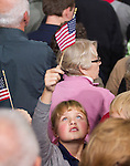 A young girl awaits the arrival of First Lady Michelle Obama at the University of Wisconsin in Wausau. The First Lady drew a crowd of 980 people, plus 600 more in an overflow room. (Christina Capasso/Polaris)