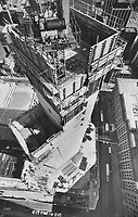 1980 FILE PHOTO - ARCHIVES -<br /> <br /> 1980 FILE PHOTO -<br /> <br /> The concrete core of the second twin tower in the Eaton Centre project is nearly finished. Star photographer Boris Spremo took the aerial picture from the end of the crane boom (circled right); about 450 feet above Queen St. Street level view is from