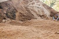 Men shovel sand at a small port in Kibuye, Rwanda on Lake Kivu. Brendan Bannon. March 1, 2014