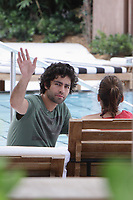 MIAMI BEACH, FL- JULY 23: Actor Adrian Grenier outside his luxury hotel, having lunch and hanging with friends poolside. on Miami Beach. on July 23, 2009 in Miami Beach, Florida<br /> <br /> <br /> People:  Adrian Grenier
