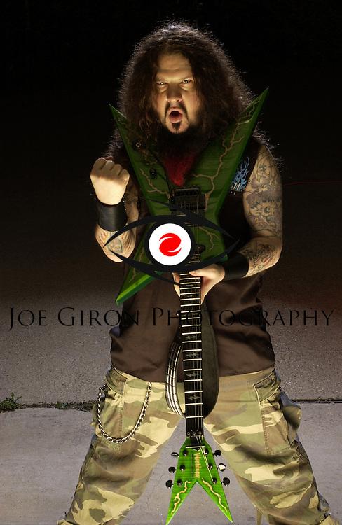 Dimebag Darrell Abbott of Pantera/Damageplan fame, poses for a portrait session.