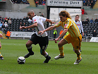 ATTENTION SPORTS PICTURE DESK<br /> Pictured: Darren Pratley of Swansea City battles with Fabricio Coloccini of Newcastle United<br /> Re: Coca Cola Championship, Swansea City Football Club v Newcastle United at the Liberty Stadium, Swansea, south Wales. 13 February 2010