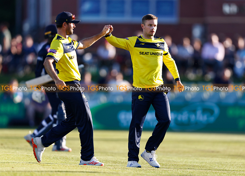 Mason Crane (R) of Hampshire is congratulated after taking the wicket of Daniel Bell-Drummond during Kent Spitfires vs Hampshire Hawks, Vitality Blast T20 Cricket at The Spitfire Ground on 9th June 2021