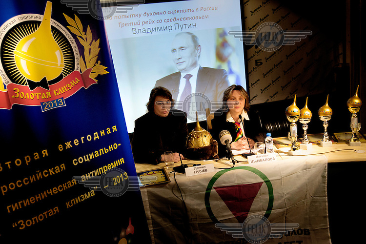 Members of the The Golden Enema awards panel. This satirical anti-prize is given to the .biggest homophobes in Russia. In 2013 the Grand-Prize was given to President Putin. This was the second year of the award ceremony and besides President Putin, prominent leaders and public figures where given prizes in categories such as: sports, religion, media, ministers etc. (MANDATORY CREDIT   photo: Mads Nissen/Panos Pictures /Felix Features)