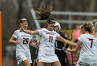 Newton, Massachusetts - February 24, 2018: NCAA Division I. Boston College (white) defeated Brown University (brown), 22-12, at Newton Campus Lacrosse Field.<br /> Goal celebration.