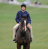 Neil Morris watches the action on horseback.