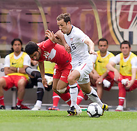 Steve Cherundolo (6) of the USMNT fights for the ball with Arda Turan (14) of Turkey at Lincoln Financial Field in Philadelphia, PA.  The USMNT defeated Turkey, 2-1.