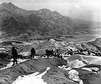 Men of the 19th Inf. Regt. work their way over the snowy mountains about 10 miles north of Seoul, Korea, attempting to locate the enemy lines and positions.  January 3, 1951.  Pfc. James J. Jacquet. (Army)<br /> NARA FILE #:  111-SC-355544<br /> WAR & CONFLICT BOOK #:  1431