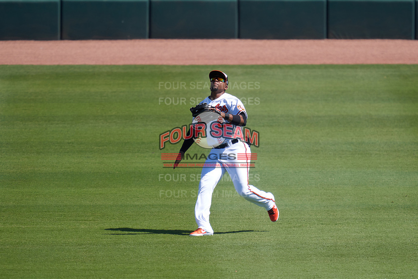 Baltimore Orioles outfielder Yusniel Diaz (23) catches a fly ball during a Major League Spring Training game against the Pittsburgh Pirates on February 28, 2021 at Ed Smith Stadium in Sarasota, Florida.  (Mike Janes/Four Seam Images)