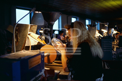 Czech Republic. Woman working on a cut crystal glass salver dish; Ruckle glass factory.