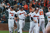 Oregon State Beavers shortstop Beau Philip (4) is congratulated by teammates after scoring a run during a game against the New Mexico Lobos on February 15, 2019 at Surprise Stadium in Surprise, Arizona. Oregon State defeated New Mexico 6-5. (Zachary Lucy/Four Seam Images)