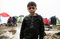 Pictured: A boy by a flooded field in the camp Tuesday 08 March 2016<br /> Re: Heavy overnight rain has flooded the migrant camp at the Greek FYRO Macedonian border of Idomeni in Greece