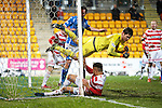 St Johnstone v Hamilton Accies....016.01.16  SPFL  McDiarmid Park, Perth<br /> Michael McGovern goes flying as he clears off the line from Chris Kane<br /> Picture by Graeme Hart.<br /> Copyright Perthshire Picture Agency<br /> Tel: 01738 623350  Mobile: 07990 594431