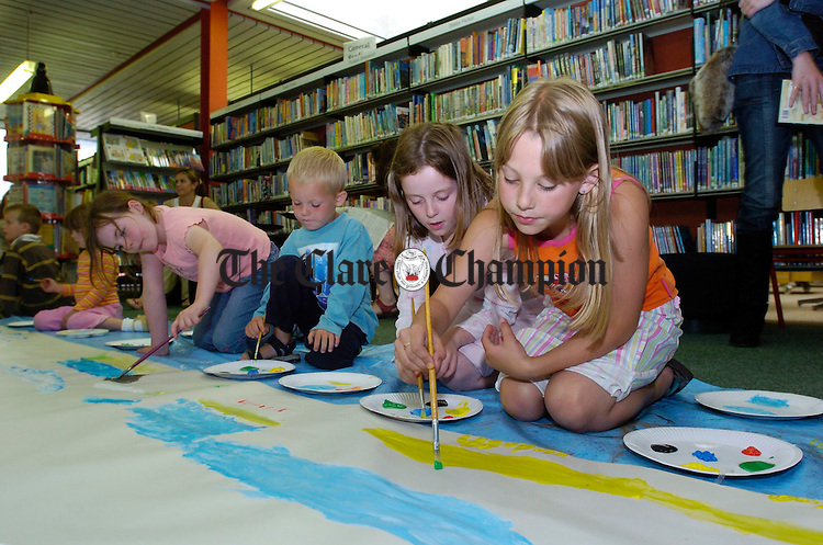 Budding artists get to grips with the skills of painting during the Summer activities for Children at the de Valera Library, Ennis. Photograph by John Kelly.