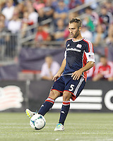 New England Revolution defender A.J. Soares (5) passes back to goalkeeper.  In a Major League Soccer (MLS) match, the New England Revolution (blue) defeated Chicago Fire (red), 2-0, at Gillette Stadium on August 17, 2013.