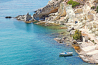 """Traditional fishermen houses with the impressive boat shelters, also known as """"syrmata"""" in Goupa of Kimolos, Greece"""