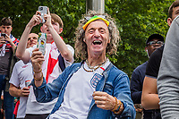 7th July 2021, Wembley Stadium, London, England; 2020 European Football Championships (delayed)  semi-final, England versus Denmark; England fans in good spirits in Arena Square, Wembley Park. 60,000 fans are set to descend to Wembley Park to watch England play Denmark