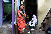 Indonesian women in a slum community in central Jakarta. It is estimated over 25% of Indonesians live in slum areas, with more than 5 million people living in slum areas in the greater Jakarta area.