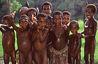 Oceania,Papua New Guinea, Septik river,children under rain in the village