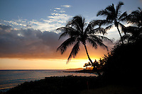 Poipu sunset with palm trees. Kauai, Hawaii.