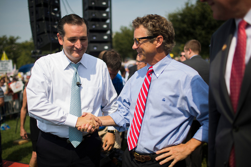 """Sen. Rand Paul (KY) and Sen. Ted Cruz (TX) attend an  """"Exempt America from Obamacare"""" Tea Party rally on Capitol Hill in Washington."""