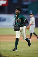 Liover Peguero (10) of the Greensboro Grasshoppers jogs off the field during the game against the Hickory Crawdads at First National Bank Field on May 6, 2021 in Greensboro, North Carolina. (Brian Westerholt/Four Seam Images)